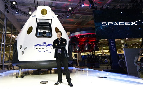 HAWTHORNE-CA-MAY 29: SpaceX CEO Elon Musk unveils the company's new manned spacecraft, The Dragon V2, designed to carry astronauts into space during a news conference on May 29, 2014, in Hawthorne, California. The private spaceflight company has been flying unmanned capsules to the Space Station delivering cargo for the past two years. The Dragon V2 manned spacecraft will ferry up to seven astronauts to low-Earth orbit. (Photo by Kevork Djansezian/Getty Images)